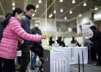 В Японии на парламентских выборах лидирует правящая коалиция