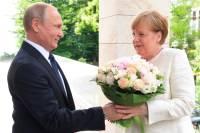 Bild: Путин преподнес Меркель оскорбительный букет