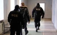 Бойцы спецназа ФСБ похищали деньги, пряча в бронежилеты