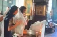 Грубо обращавшегося с младенцем во время крещения священника отстранили от службы
